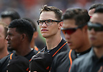 San Francisco Giants' Kelby Tomlinson listens to the National Anthem before a spring training game against the Milwaukee Brewers in Phoenix, AZ, on Thursday, March 23, 2017.<br /> Photo by Cathleen Allison/Nevada Photo Source