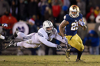 Tarean Folston (25) carries the ball as BYU Cougars linebacker Kyle Van Noy (3) attempts to tackle in the fourth quarter.
