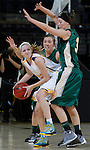 RAPID CITY, S.D. -- JANUARY 11, 2014 -- Jessica Shull #12 of S.D. Mines gets pressured by Black Hills State defenders Cassidy Kotelman and Dakota Barrie during their game Saturday at the Rushmore Plaza Civic Center Ice Arena Saturday.  (photo by Dick Carlson/Inertia)