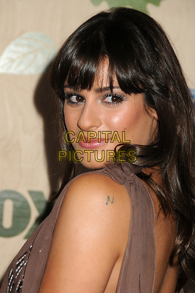 Lea Michele.7th Annual Fox Fall Eco-Casino Party held at The Bookbindery, Culver City, California, USA..September 12th, 2011.headshot portrait silver beige sleeveless tattoo brown looking over shoulder musical note.CAP/ADM/BP.©Byron Purvis/AdMedia/Capital Pictures.