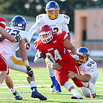 SIOUX FALLS, SD - SEPTEMBER 25: Cory Fichter #34 from Lincoln tries to slip the grasp of Kaden Eckhoff #50 form Aberdeen Central in the first quarter of their game Friday night at Howard Wood Field. (Photo by Dave Eggen/Inertia)