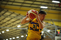 Action from the 2017 AA Boys' Secondary Schools Basketball Premiership National Championship match between Shirley Boys' High School (sky blue) and Rongotai College (yellow) at the B&M Centre in Palmerston North, New Zealand on Tuesday, 3 October 2017. Photo: Dave Lintott / lintottphoto.co.nz