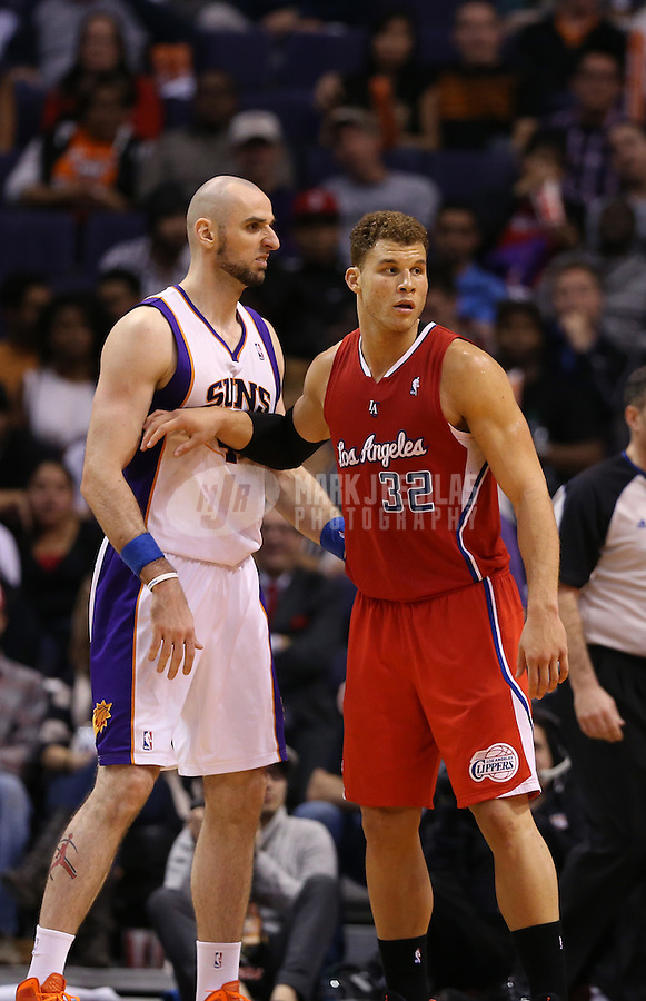 Jan. 24, 2013; Phoenix, AZ, USA: Los Angeles Clippers forward Blake Griffin (32) against Phoenix Suns center Marcin Gortat (4) at the US Airways Center. The Suns defeated the Clippers 93-88. Mandatory Credit: Mark J. Rebilas-USA TODAY Sports