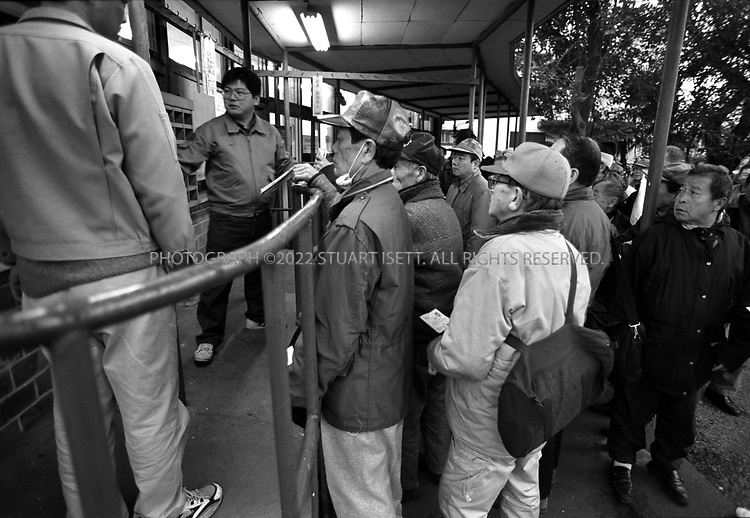 Osaka, Japan.Homeless men gather at an outdoor job center in Tokyo's Toyama park in Shinjuku, an area in Tokyo with thousands of homeless...All photographs ©2003 Stuart Isett.All rights reserved.This image may not be reproduced without expressed written permission from Stuart Isett.