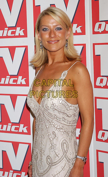ZOE LUCKER.TV Quick Awards At The Dorchester, London.half length, half-length, plunging neckline, cleavage, beige, floral print.www.capitalpictures.com.sales@capitalpictures.com.©Capital Pictures