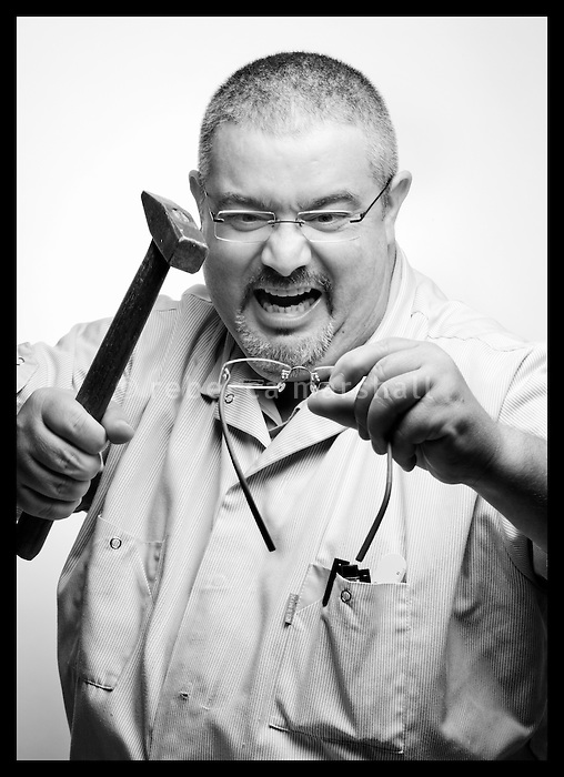 Portrait of staff member of Grosgogeat Opticiens, 25 Avenue Jean Medecin, Nice, 13 September 2011