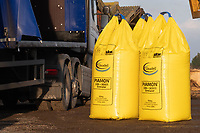Farmer unloading one ton bags of nitrogen from a lorry <br /> &copy;Tim Scrivener Photographer 07850 303986<br />      ....Covering Agriculture In The UK....