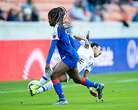 HOUSTON, TX - JANUARY 31: Batcheba Louis #7 of Haiti upends Gabriela Guillen #2 of Costa Rica during a game between Haiti and Costa Rica at BBVA Stadium on January 31, 2020 in Houston, Texas.