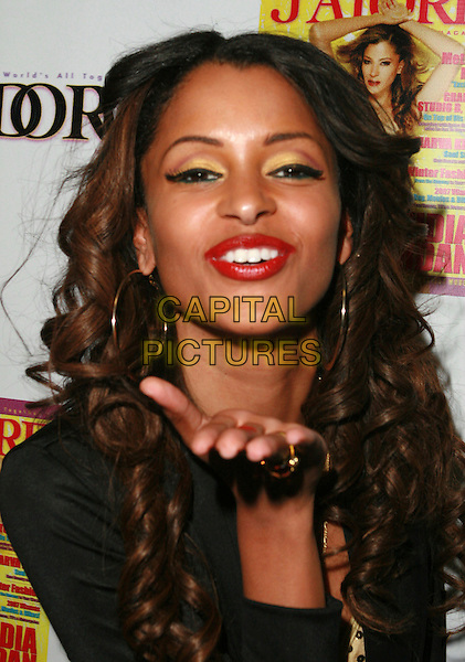 CLAUDIA JORDAN .At Claudia Jordan's Birthday Party held at Skateland, Northridge, California, USA, 12 April 2007..portrait headshot hand.CAP/ADM/CH.©Charles Harris/AdMedia/Capital Pictures.