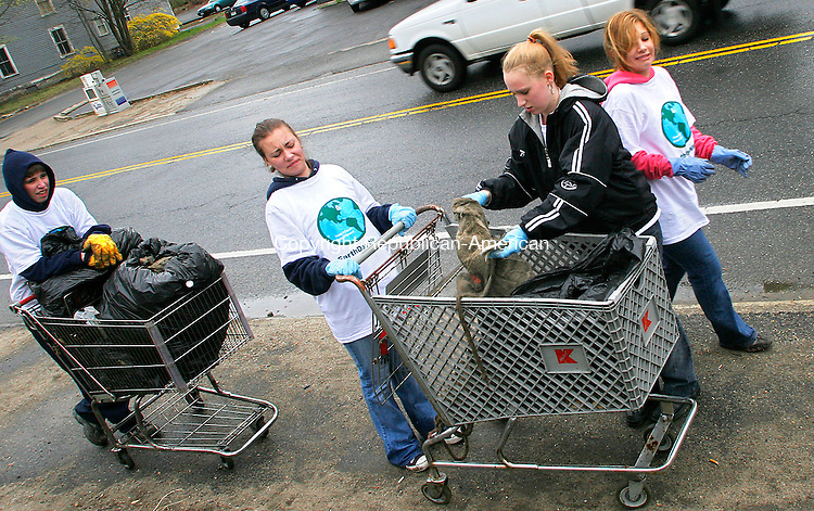 TORRINGTON, CT- 22 APRIL 2006- 042206JW03.jpg  -- Torrington High school Civics Club President Kelsey Gelgud grimaces while club member Katie Krause puts a dirty towl into their trash bags as fellow members Travis Mazzochi and Lindsay Boyer look on. The club cleaned South Main Street in Torrington Saturday morning during Earth Day clean-up with the help of two abandoned shopping carriages, one of which they pulled from the Naugatuck River.  Jonathan Wilcox Republican-American