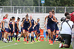 19 August 2014: Abby Wambach (right) and Carli Lloyd (left) lead teammates in a training exercise. The United States Women's National Team held a public training session at WakeMed Stadium in Cary, North Carolina.