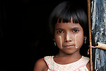 A Rohingya girl in the Jamtoli Refugee Camp near Cox's Bazar, Bangladesh. Her face is marked with thanakha, a traditional Burmese cosmetic.<br /> <br /> More than 600,000 Rohingya have fled government-sanctioned violence in Myanmar for safety in Bangladesh.