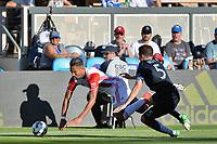 San Jose, CA - Saturday June 17, 2017: Danny Hoesen, Matt Besler during a Major League Soccer (MLS) match between the San Jose Earthquakes and the Sporting Kansas City at Avaya Stadium.