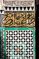 Meknes, Morocco.  Medersa Bou Inania, 14th. Century.  Calligraphy on Decorative Tiles on a Column.