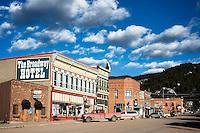 Brick storefronts line West Broadway Street in Philipsburg, Montana.
