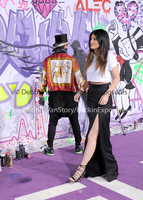 LOS ANGELES, CA - December 18: Kylie Jenner arrives at Justin Bieber`s Believe World Premiere held at The Premiere House at Regal Cinemas L.A. Live in Los Angeles, California on December 18,2013                                                                               © 2013 Hollywood Press Agency
