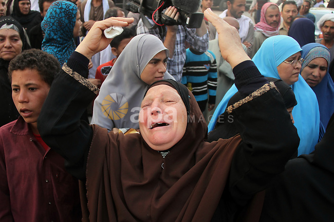 Relatives and families of members of Muslim Brotherhood and supporters of ousted President Mohamed Mursi react after hearing the sentence, in front of the court in Minya, south of Cairo, April 28, 2014. An Egyptian court has recommended the death sentence for the leader of the Muslim Brotherhood and 682 supporters, and handed down a final capital punishment ruling for 37 others, judicial sources said on Monday. Photo by Mohammed Bendari