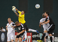 Real Salt Lake goalkeeper Nick Rimando (18) goes up to defend the play.   DC United and Real Salt Lake tied 0-0 at RFK Stadium, Wednesday  June 2  2010.