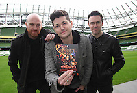 "NO REPRO FEE: 1.12.2011: Irish trio The Script pictured at the Aviva Stadium Dublin to mark the release of their first concert DVD ""HOMECOMING: LIVE AT THE AVIVIA STADIUM DUBLIN"" filmed by acclaimed director Dick Carruthers ( Oasis, White Stripes, Paul McCartney.) 98FM's Thunder Trio Jeri Mahon, Mary Scott and Angela Frawley joined band members Danny, Mark and Glen reliving the experience of playing on home turf to a 54,000 strong crowd! The Script were back in Dublin earlier this year on July 2nd  to play the sold-out show, the event that marked the pinnacle of the band's career to date coming just 3 years after their 1st gig at Dublin's Sugar Club in front of 28 people. The DVD is of the entire concert, includes their hits ""The Man Who Can't be Moved"", ""Nothing"" and ""Breakeven."" Pictured (l-r) at the DVD launch were Script band members Glen Power, Danny O'Donoghue and Mark Sheehan. Picture Collins."