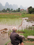 Man, rice fields and karst scenery Jiu Xian, China