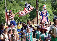 Stilt walkers Samantha Hyman, left, of Philadelphia, Pennsylvania and Charles Watts of Queens, New York wave to the crowd during the Middletown Township 4th of July Independence Day Parade Monday July 4, 2016 in Middletown Township, Pennsylvania. (Photo by William Thomas Cain)
