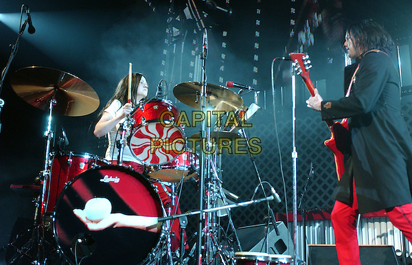 THE WHITE STRIPES - MEG WHITE & JACK WHITE.Live at the 106.7 KROQ Almost Acoustic Christmas 2005 night two held at The Gibson Ampitheatre in Universal City, California..December 11th, 2005.Ref: DVS.full length stage concert music performance gig drum kit.www.capitalpictures.com.sales@capitalpictures.com.Supplied By Capital PIctures