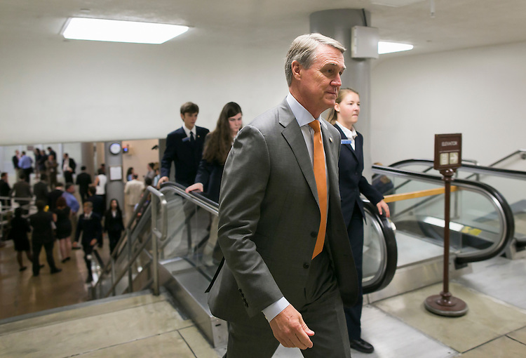 UNITED STATES - JULY 21: Sen. David Perdue, R-Ga., heads to the weekly Senate Republicans' policy luncheon on Capitol Hill on Tuesday, July 21, 2015. (Photo By Al Drago/CQ Roll Call)
