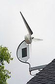 """Installation of a residential wind turbine is filmed for an episode of the DIY network show """"This New House"""". Bob Hayes of Winds and his crew install a Dyocore SolAir 800 I wind turbine which integrates two small solar panels into its design and is capable of producing up to 800 Watts at 12 mph. The two solar panels produce up to 45watts. Redondo Beach, Ca, USA"""