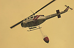 August 21, 2001 Coulterville, California  -- Creek Fire – CDF helicopter returns from dropping water on spot fire on Cuneo Road.The Creek Fire burned 11,500 acres between Highway 49 and Priest-Coulterville Road a few miles north of Coulterville, California.
