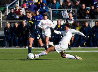 Alina Garciamendez (4) of Stanford tries to tackle the ball away from Mandy Laddish (2) of Notre Dame during the final of the NCAA Women's College Cup at WakeMed Soccer Park in Cary, NC.  Notre Dame defeated Stanford, 1-0.
