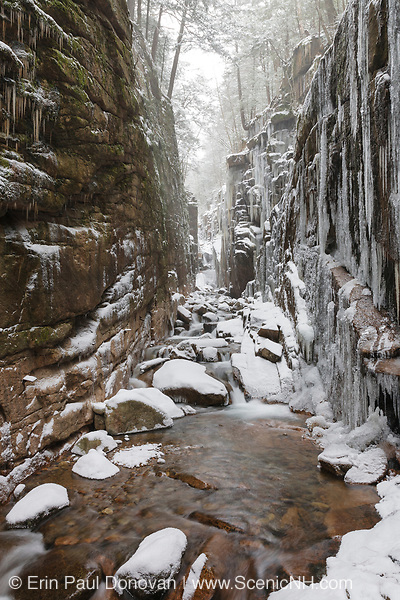 Franconia Notch State Park - Flume Gorge in Lincoln, New Hampshire USA during a snow storm. Blowing snow can be seen.
