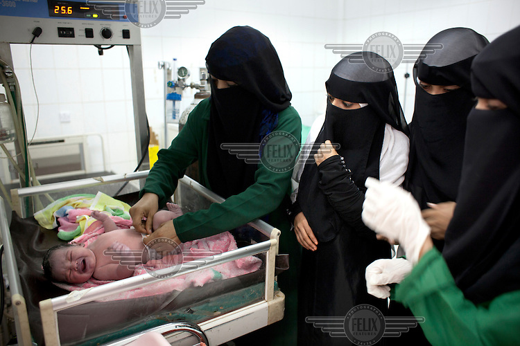 Students at the Health Science Institute in Houdeidah attend to a new born baby during a class in midwifery. Many of the young women at this college come from the surrounding countryside and the plan is that they will return to work in their villages where there is one midwife for every 8,000 people.  ..
