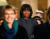 First lady Michelle Obama walks through the crypt on her way to watch US President Barack Obama get sworn-in for a second term along with President Barack Obama, by Supreme Court Chief Justice John Roberts during his public inauguration ceremony at the U.S. Capitol Building in Washington, D.C. on January 21, 2013.       .Credit: Molly Riley / Pool via CNP