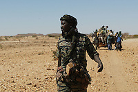 SLA ( sudan liberation army) battalion commander Hassan Bijou leads his men into battle against the Janjaweed, armed arab militias, in northen darfur on Dec 2004