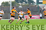 brian Looney Dr Crokes goes takes on Ciaran o'Connell and Denis McElligott Stacks during their County Championship clash in Fitzgerald Stadium on sunday