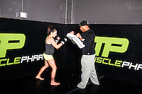 MMA fighter Cat Zingano (cq) trains with Head of Team Management for Muscle Pharm Anthony Dunn (cq) at a MusclePharm gym in Denver, Colorado, Friday, November 7, 2014. In 2013, Zingano became the first woman to win a UFC fight by technical knockout and is currently the number three ranked pound-for-pound female MMA fighter in the world.<br /> <br /> Photo by Matt Nager