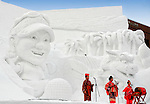 Performers from Okinawa perform traditional dance in front of a sculpture depicting aspects of Okinawan culture during the Sapporo Snow and Ice Festival in Sapporo City, northern Japan. Around 2 million people visit the city to see the hundreds of hand-crafted snow and ice sculptures that have graced the Sapporo Snow and Ice Festival since its inception in 1950.