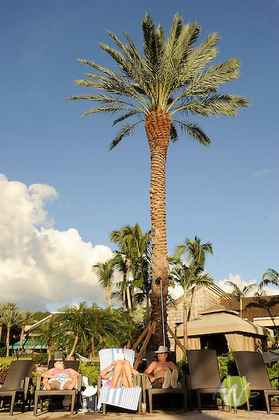 Westin Resort, St. John, USVI, Caribbean. Sunbathing by pool.