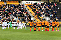Swansea and Wolverhampton players applaud in tribute to John Hendley who worked for the Club during the Emirates FA Cup match between Wolverhampton Wanderers and Swansea City at The Molineux Stadium, Wolverhampton, England, UK. Saturday 06 January 2018
