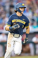 Michigan Wolverines outfielder Jesse Franklin (7) runs to first base during Game 6 of the NCAA College World Series against the Florida State Seminoles on June 17, 2019 at TD Ameritrade Park in Omaha, Nebraska. Michigan defeated Florida State 2-0. (Andrew Woolley/Four Seam Images)