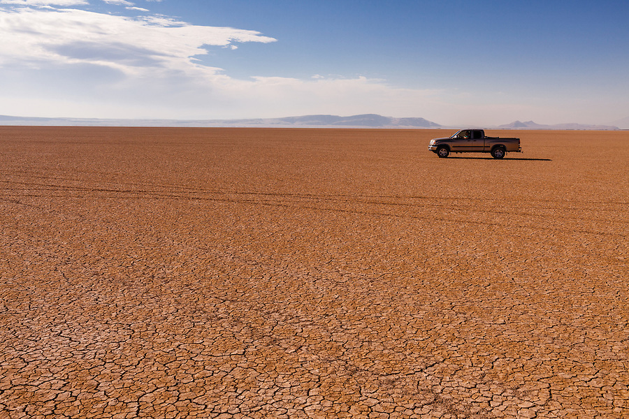 A man sits inside a 2002 Toyota Tundra on the Alvord Desert in Harney County, Southeast Oregon.