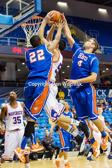 Houston Baptist Huskies guard/forward Dauson Womack (22), Houston Baptist Huskies forward Art Bernardi (4) and Texas-Arlington Mavericks forward Jordan Reves (55) in action during the game between the Houston Baptist Huskies and the Texas-Arlington Mavericks at the College Park Center arena in Arlington, Texas. UTA defeats Houston Baptist 81 to 47...
