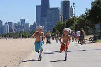 Ready, set, go, Chicago's Lakefront Trail, across from Lincoln Park, the white sand beaches and clean waters of Lake Michigan make for a perfect family summer day.