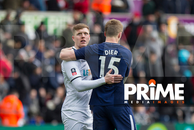 Alfie Mawson of Swansea City and Eric Dier of Tottenham Hotspur at full time of the FA Cup Quarter Final match between Swansea City and Tottenham Hotspur at the Liberty Stadium, Swansea, Wales on 17 March 2018. Photo by Mark  Hawkins / PRiME Media Images.