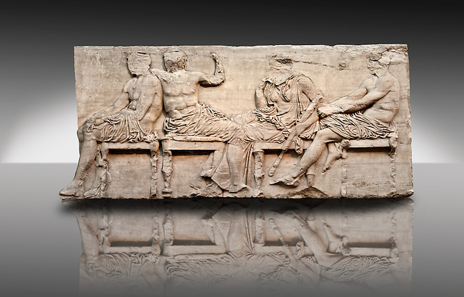 Marble Releif Sculptures from the east frieze around the Parthenon Block IV 24-27. From the Parthenon of the Acropolis Athens. A British Museum Exhibit known as The Elgin Marbles. Far Richt Ares sits holding his knee  to his left Demeter is leaning on one wrist, a sign of mouring, grieving for her daughter Persaphone who had been abducted by the gods of the underworld.