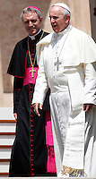 Papa Francesco, affiancato dal Prefetto della Casa Pontificia Monsignor Georg Gaenswein, al termine dell'udienza generale del mercoledi' in Piazza San Pietro, Citta' del Vaticano, 26 giugno 2013.<br /> Pope Francis, flanked by Prefect of the Papal Household Monsignor Gaenswein, leaves at the end of his weekly general audience in St. Peter's Square at the Vatican, 26 June 2013.<br /> UPDATE IMAGES PRESS/Isabella Bonotto<br /> <br /> STRICTLY ONLY FOR EDITORIAL USE