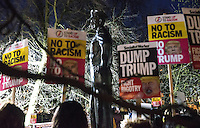 Image ©Licensed to i-Images Picture Agency. 20/01/2017. London, United Kingdom.Demonstrators protest against Donald Trump's presidency outside the American embassy in London in front of a statue of former president Dwight D.Eisenhower.Picture by Mark Thomas / i-Images
