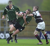 Sport - Rugby 27/04/2002 Parker Pen Shield - Semi-Final.London Irish vs Pontypridd - Kassam Stadium - Oxford.Exiles Geoff Appleford  is tackled by Ceri Sweeney..[Mandatory Credit, Peter Spurier/ Intersport Images].