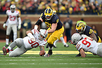 Ohio State Buckeyes defensive lineman Tommy Schutt (90) grabs a fumble that was called back in the fourth quarter of the college football game between the Michigan Wolverines and the Ohio State Buckeyes at Michigan Stadium in Ann Arbor, Saturday afternoon, November 28, 2015. The Ohio State Buckeyes defeated the Michigan Wolverines 42 - 13. (The Columbus Dispatch / Eamon Queeney)