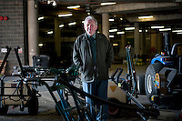 Eddie Seaward, Head Groundsman amongst machinery underneath No1 Court at Wimbledon, The All England Lawn Tennis Club (AELTC), London...